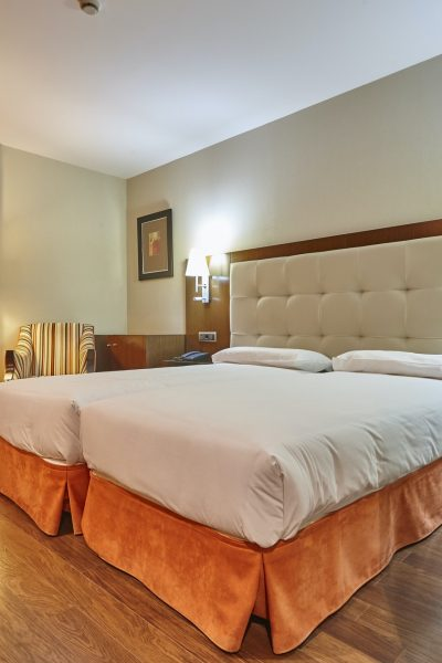 modern-hotel-room-interior-with-two-separate-beds-tourism-business.jpg